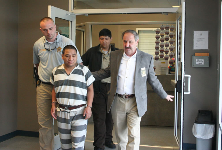 DeKalb County Sheriff Jimmy Harris and other officials walk Santos Mendez Ambrocio to jail. (Photo: DeKalb County Sheriff's Office)