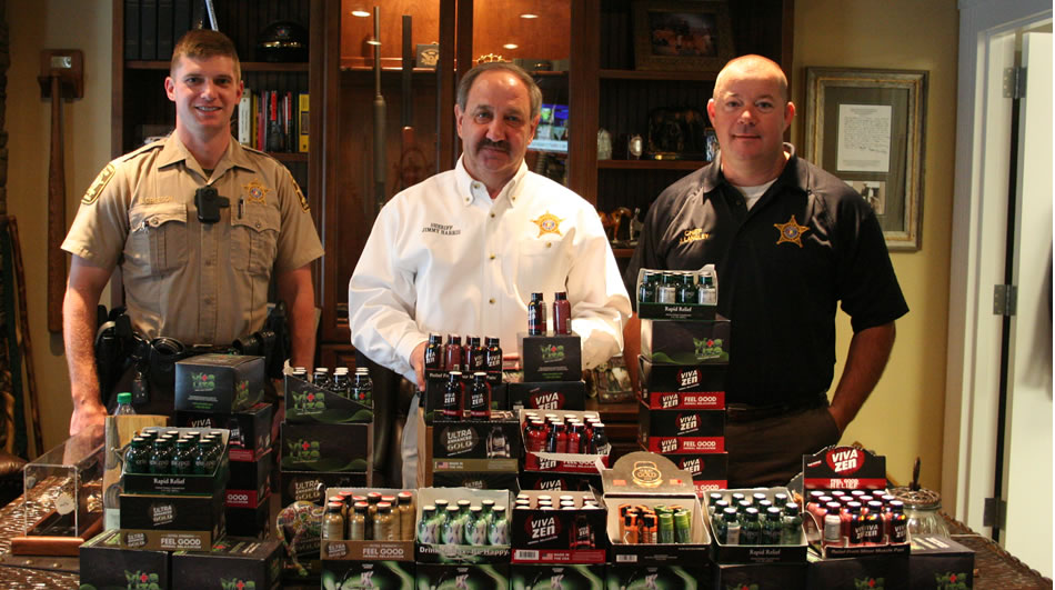 DeKalb County Sheriff Jimmy Harris, center, and staff show Kratom products seized from local store shelves. Kratom is now illegal in Alabama. (Photo: DeKalb County Sheriff's Office)
