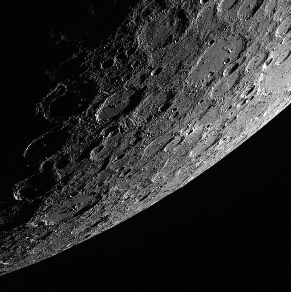 In this scene, which was acquired by the MESSENGER spacecraft looking from the shadows toward the sunlit side of the planet Mercury, a 120-km (75 mi.) impact crater stands out near the center. (Image: NASA.gov)