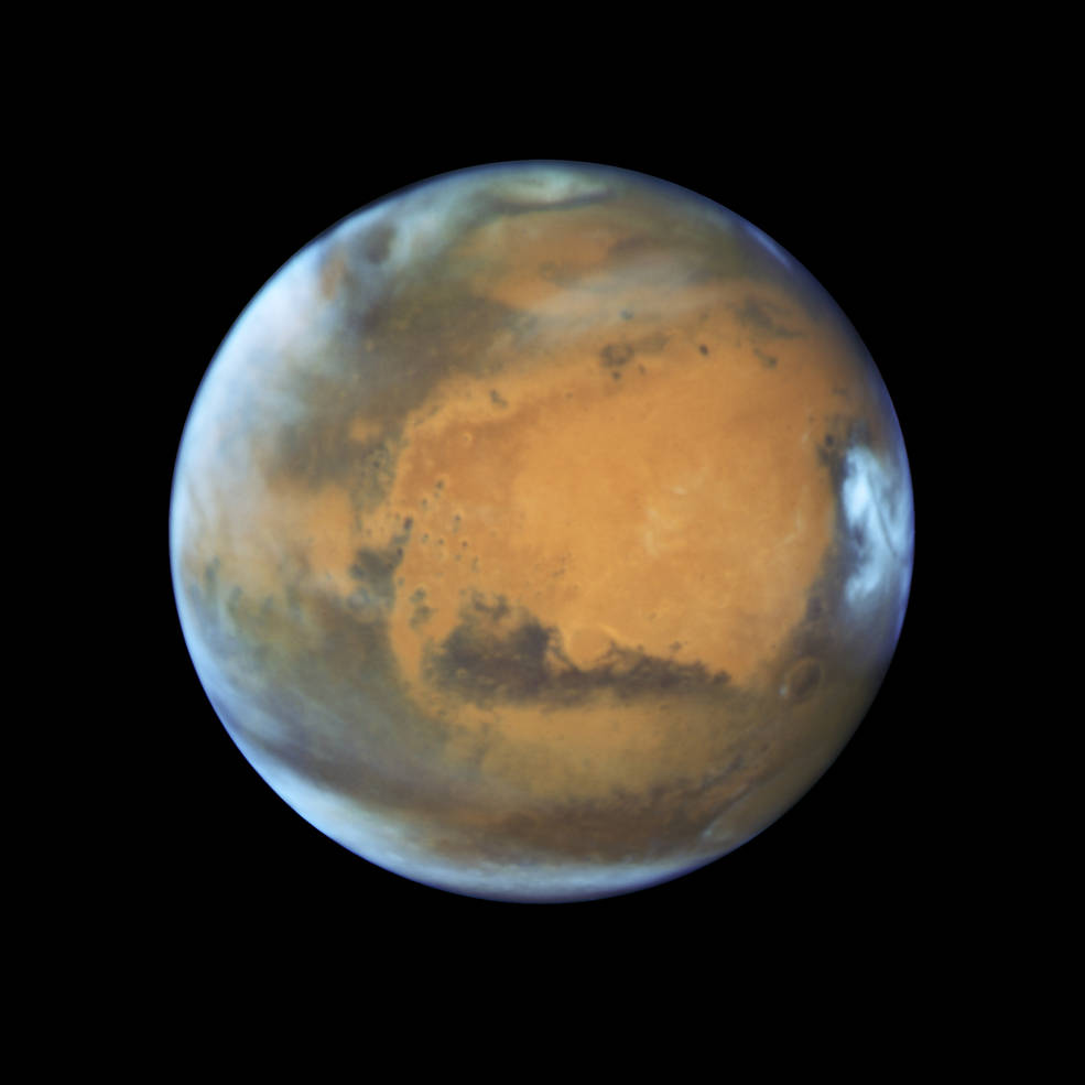 Hubble Space Telescope photo of Mars taken when the planet was 50 million miles from Earth on May 12, 2016. Credits: NASA, ESA, the Hubble Heritage Team (STScI/AURA), J. Bell (ASU), and M. Wolff (Space Science Institute)