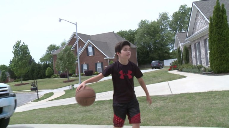 Isaac Allen shows us his basketball skills.