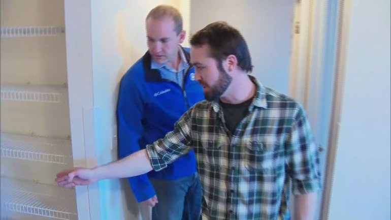 Landon Mannick shows reporter Matt Kroschel where he saw the bear and what he did to stay away from it.