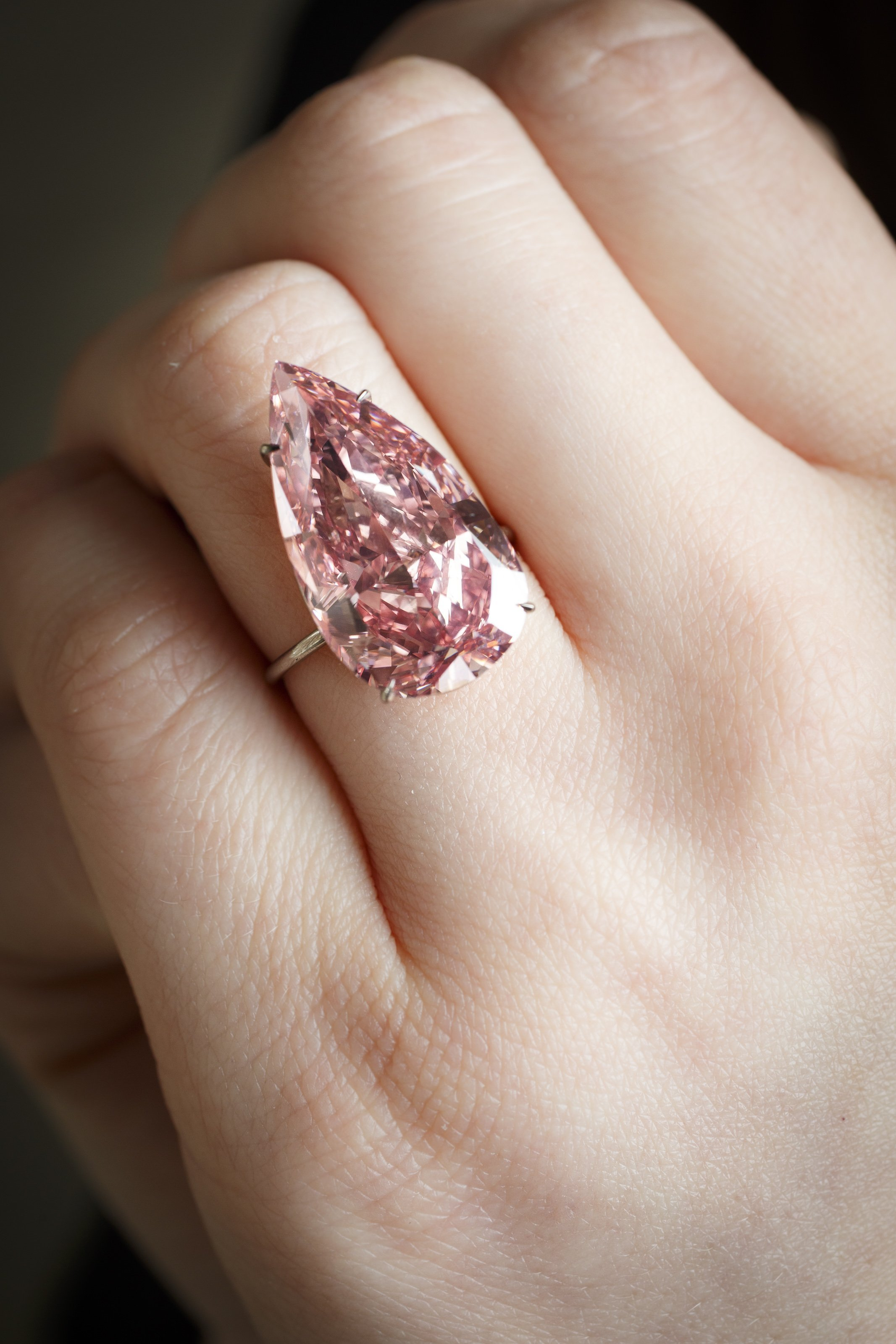 An extremely rare 15.38 carat pear-shaped pink diamond -- called the 'Unique Pink' -- sold for $31.6 million at Sotheby's in Geneva on Tuesday (May 17, 2016).