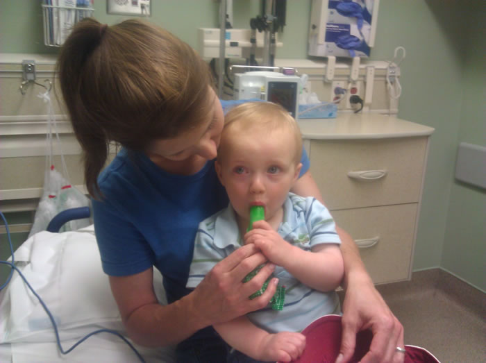 Melissa Riopka with son Sam in the ER after his outbreak to peanuts