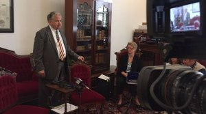 State Auditor Jim Zeigler waits for Governor Robert Bentley to show up. (Kristen Conner/WHNT News 19)