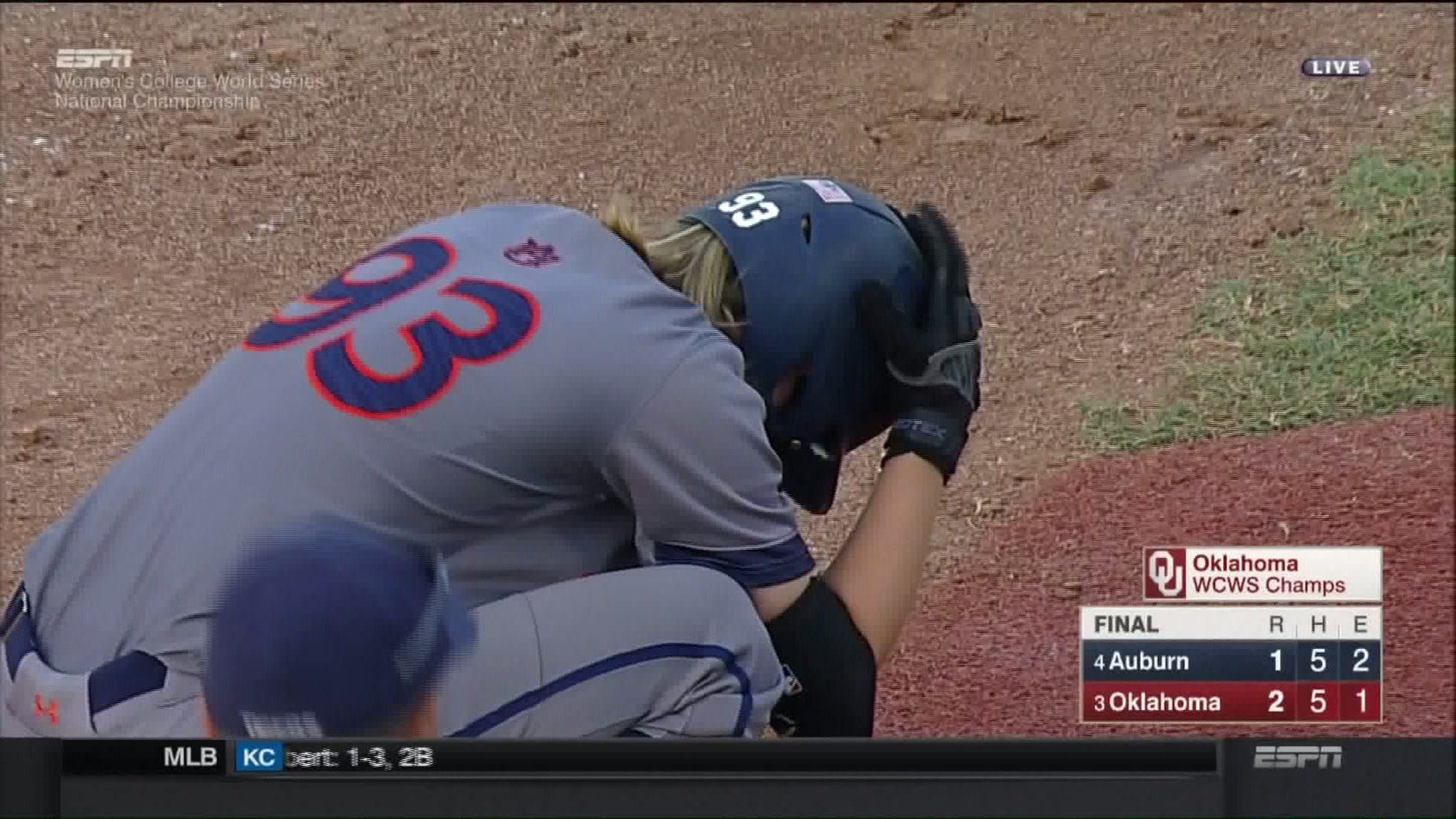 Auburn softball player Courtney Shea reacts to the team's loss of Game 3