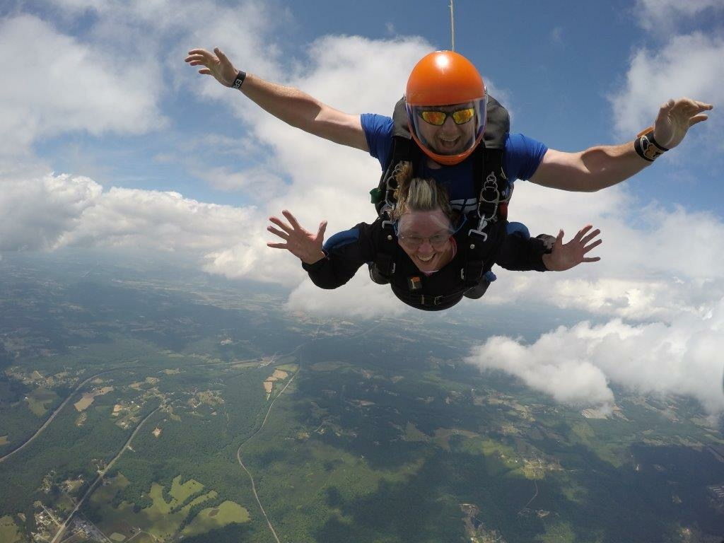 Pat, who recently turned 80, and Eddie as he guides her through her first skydive. (Image: Skydive Alabama)