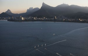 RIO DE JANEIRO, BRAZIL - JULY 04: Sailboats sail in the polluted Guanabara Bay, venue site of the Olympic sailing events, on July 4, 2016 in Rio de Janeiro, Brazil. July 5 marks the one-month mark to the beginning of the Rio 2016 Olympic Games with an economic crisis, political turmoil and Zika virus fears roiling the country. (Photo by Mario Tama/Getty Images)