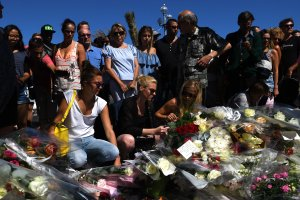 NICE, FRANCE - JULY 15: People visit the scene and lay tributes to the victims of a terror attack on the Promenade des Anglais on July 15, 2016 in Nice, France. A French-Tunisian attacker killed 84 people as he drove a lorry through crowds, gathered to watch a firework display during Bastille Day Celebrations. The attacker then opened fire on people in the crowd before being shot dead by police. (Photo by David Ramos/Getty Images)