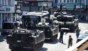 "This picture taken on July 16, 2016 shows abandoned tanks in the street after police took over the military position at the Anatolian side at Uskudar in Istanbul. President Recep Tayyip Erdogan urged Turks to remain on the streets on July 16, 2016, as his forces regained control after a spectacular coup bid by discontented soldiers that claimed more than 250 lives. Describing the attempted coup as a ""black stain"" on Turkey's democracy, Yildirim said that 161 people had been killed in the night of violence and 1,440 wounded. / AFP / BULENT KILIC (Photo credit should read BULENT KILIC/AFP/Getty Images)"