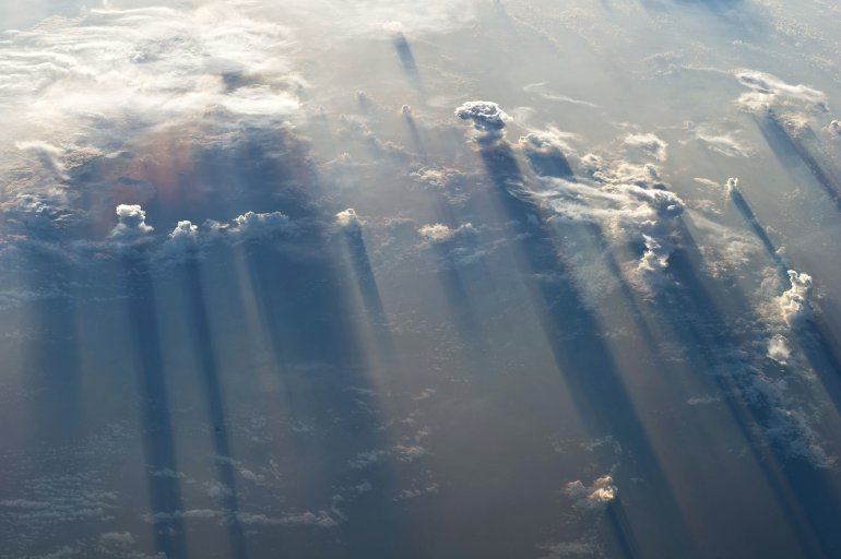 Clouds and their long shadows photographed as the International Space Station orbited above the North Pacific Ocean (latitude 14.3, longitude -102.4) on 19 May 2011 at 12:20:26 GMT: