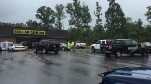 Police and sheriff's deputies are stationed at a Dollar General store in the Wilson community of Lauderdale County. (Photo: Carter Watkins/WHNT News 19)