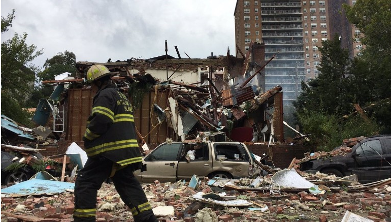 A firefighter at the scene of a Bronx building explosion that killed a battalion chief and injured 20. (Photo courtesy NYC Mayors Office)