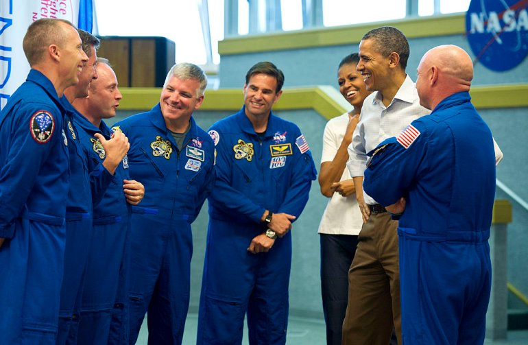 CAPE CANAVERAL, FL - APRIL 29: In this handout photo provided by NASA, President Barack Obama and First Lady Michelle Obama meet with space shuttle Endeavor commander Mark Kelly (R), and shuttle astronauts, (L-R) Andrew Feustel, European Space Agency's Roberto Vittori, Michael Fincke, Gregory H. Johnson, and Greg Chamitoff, after their launch was scrubbed April 29, 2011 at the Kennedy Space Center in Cape Canaveral, Florida. President Barack Obama visited Cape Canaveral Friday despite NASA postponing the launch of the Space Shuttle Endeavour. (Photo By Bill Ingalls/NASA via Getty Images)