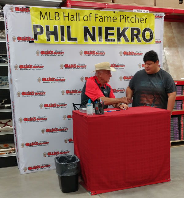 MLB Hall of Fame pitcher Phil Niekro signs an autograph for a fan at the opening of Ollie's Bargain Outlet in Albertville. (Photo: Laura Christmas/WHNT News 19)