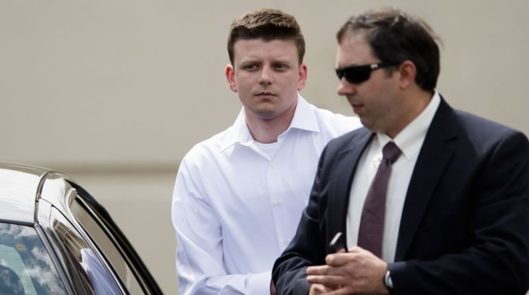 Aaron Smith, in the white shirt, with his lawyer (Albert Cesare/The Montgomery Advertiser via AP)