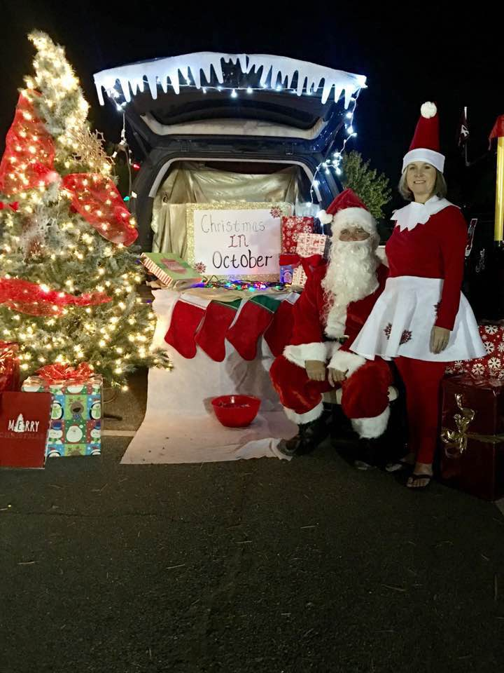 David and Vandy Sharp dressed up as Santa Claus and the Elf on the Shelf for Priceville Elementary's Trunk or Treat in October.