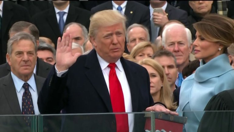 Donald Trump takes the Oath of Office to become 45th President of the United States, with his wife Melania at his side.