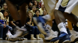 Donna Dye watches from the front row as Decatur Central takes on Mount Vernon.