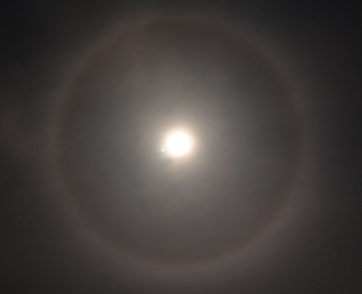 A halo moon forms when thin, high clouds move in