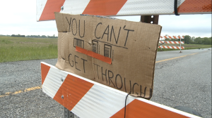 "This hand written sign is meant to ward off drivers who disregard the posted ""Road Closed"" sign on Whiteland Road."