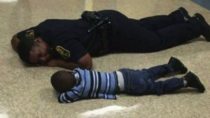 Sgt. Precious Cornner-Jones with the young boy.