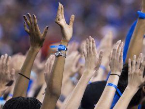 Duke fans wave at television cameras, near the beginning of the second half NCAA Men's Basketball Championships, Lucas Oil Stadium, Wisconsin vs. Duke, Indianapolis, Monday, April 6, 2015. Duke won 68-63.   Robert Scheer / The Star