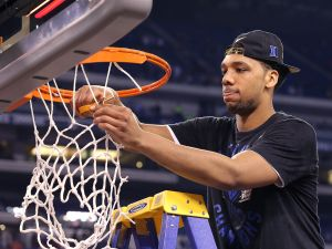 Duke Blue Devils Jahlil Okafor (15) cuts down the nets following 68-63 win over Wisconsin. The Duke Blue Devils play the Wisconsin Badgers in the NCAA Division 1 Men's Basketball Championship game Monday, April 6, 2015, evening at Lucas Oil Stadium.   Matt Kryger / The Star