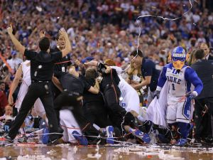 Duke players, coaches and staff pile on the floor after defeating Wisconsin 68-63 in the 2015 NCAA National Championship game Monday, April 6, 2015, at Lucas Oil Stadium.  Matt Detrich/The Star