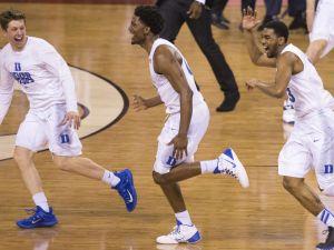 Duke players celebrate their victory, NCAA Men's Basketball Championships, Lucas Oil Stadium, Wisconsin vs. Duke, Indianapolis, Monday, April 6, 2015. Duke won 68-63.   Robert Scheer / The Star