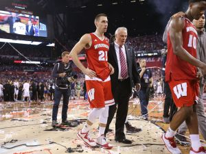 Wisconsin Badgers guard Josh Gasser and Wisconsin Badgers head coach Bo Ryan walk off the court after losing to Duke 68-63 in the NCAA Championship game at Lucas Oil Stadium on Monday, April 6, 2015.  Matt Detrich/The Star