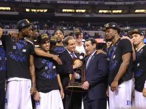 The Duke Blue Devils are presented the NCAA Championship Trophy and interviewed by CBS Sports announcer Jim Nance. Duke beat Wisconsin 68-63 in the 2015 Men's NCAA National Championship at Lucas Oil Stadium Monday, April 6, 2015.  Matt Kryger/The Star