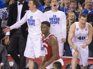 Duke bench players celebrate during the second half of their victory, NCAA Men's Basketball Championships, Lucas Oil Stadium, Wisconsin vs. Duke, Indianapolis, Monday, April 6, 2015. Duke won 68-63.   Robert Scheer / The Star
