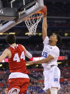 Duke Blue Devils center Jahlil Okafor (15) goes up for a dunk in the first half of the 2015 NCAA National Championship game Monday, April 6, 2015, at Lucas Oil Stadium.  Matt Detrich/The Star