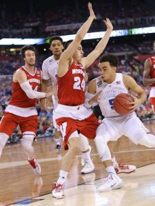Duke Blue Devils guard Tyus Jones (5) drives in against Wisconsin Badgers guard Bronson Koenig (24) in the first half of the 2015 NCAA National Championship game Monday, April 6, 2015, at Lucas Oil Stadium.  Matt Detrich/The Star