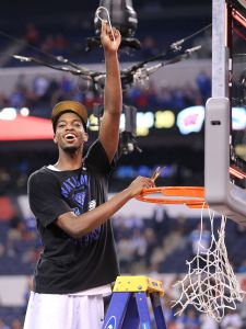 Duke Blue Devils forward Amile Jefferson celebrates with the fans while cutting down the net after beating Wisconsin 68-63 in the NCAA Championship game at Lucas Oil Stadium on Monday, April 6, 2015.  Matt Detrich/The Star