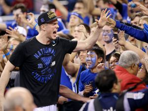 Duke Blue Devils center Marshall Plumlee celebrates with the fans after beating Wisconsin 68-63 in the NCAA Championship game at Lucas Oil Stadium on Monday, April 6, 2015.  Matt Detrich/The Star