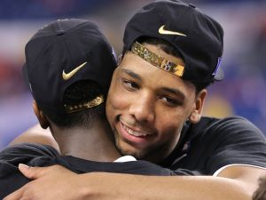 Duke Blue Devils center Jahlil Okafor celebrates with a teammate after beating Wisconsin 68-63 in the NCAA Championship game at Lucas Oil Stadium on Monday, April 6, 2015.  Matt Detrich/The Star