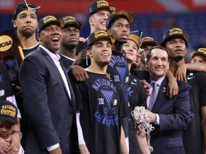 """Duke Blue Devils head coach Mike Krzyzewski is all smiles along with his team while watching the """"One Shining Moment"""" video after beating Wisconsin 68-63 in the NCAA Championship game at Lucas Oil Stadium on Monday, April 6, 2015.  Matt Detrich/The Star"""