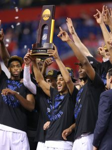 Duke Blue Devils players hold up the NCAA Championship trophy after defeating Wisconsin in the 2015 NCAA National Championship game Monday, April 6, 2015, at Lucas Oil Stadium.  Matt Detrich/The Star