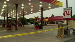 Crime scene taped off while detectives investigate shooting of gas station clerk Friday