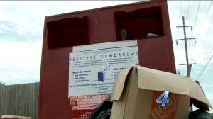 Woman stuck in donation box