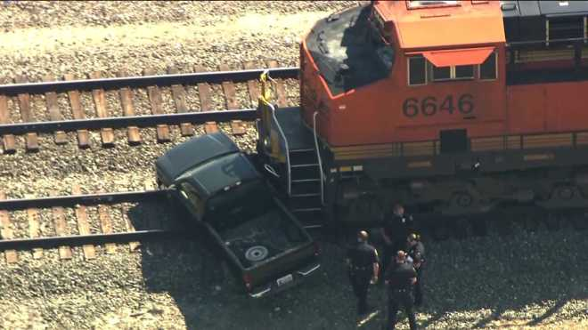 Norman train vs. truck front