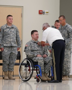 Sgt. E.H. Pittman receives the Soldier's medal