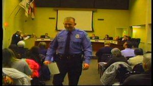 In this February 11, 2014 image from video released by the City of Ferguson, Missouri, officer Darren Wilson attends a city council meeting. Wilson is the officer who shot and killed Michael Brown on August 9, 2014. Credit:City of Ferguson