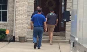Jared Fogle walking into home. Photo credit: WXIN