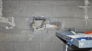 Hole in concrete wall