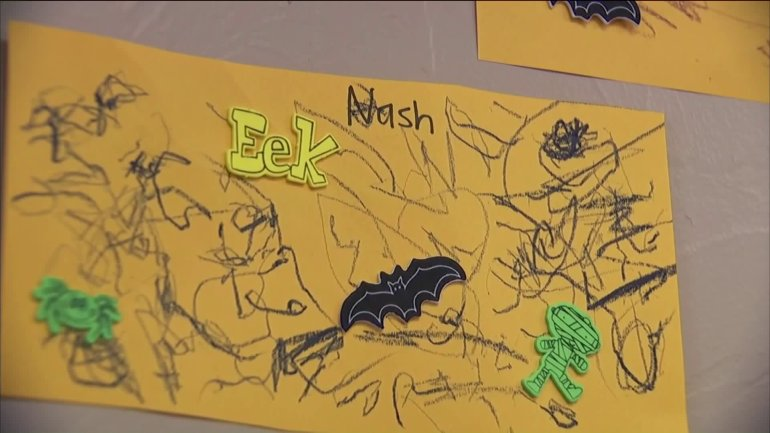 Nash's artwork still hangs on the walls of his classroom.