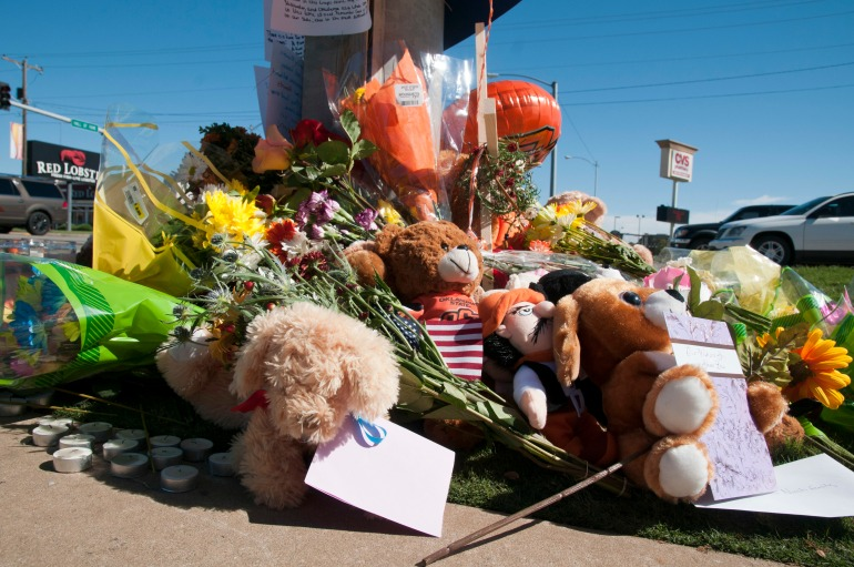 A memorial is set up at the intersection in remembrance of those lost after a woman drove through a crowd watching the Oklahoma State University homecoming parade, killing four and injuring more than 40 others on Oct. 24, in Stillwater, Okla. Soldiers of the 45th Infantry Brigade Combat Team marched earlier that morning in the parade. Upon hearing of the incident, Soldiers jumped into action, to assist first responders with providing immediate aid to the injured, provided security at the site, and helped civilians find their family members. (U.S. Army photo by Sgt. Anthony Jones, 45th Infantry Brigade Combat Team)
