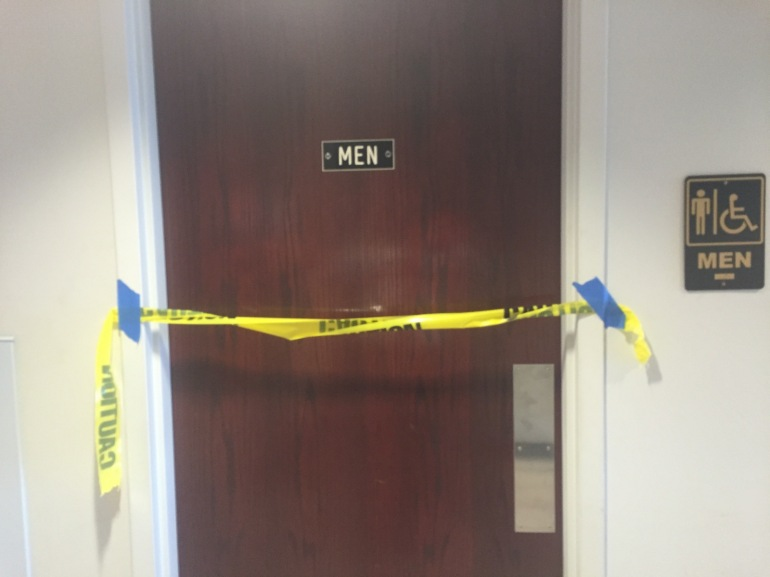 The bathrooms are closed off with caution tape.